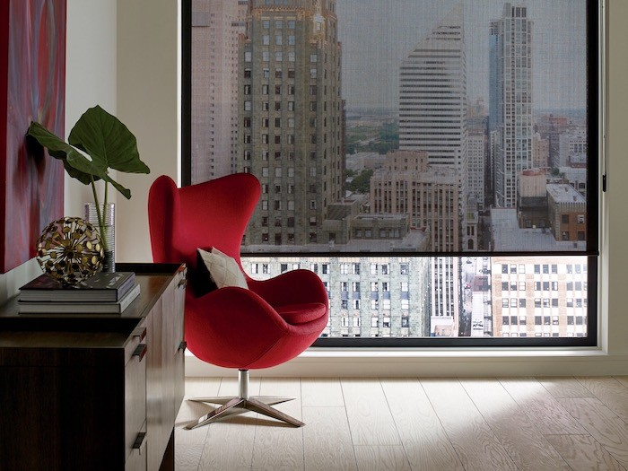 A room with a red side chair.